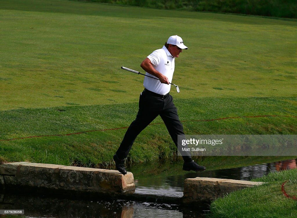 Phil Mickelson crosses a creek on the 14th hole during the second round of The Memorial Tournament at Muirfield Village Golf Club on June 3, 2016 in Dublin, Ohio.