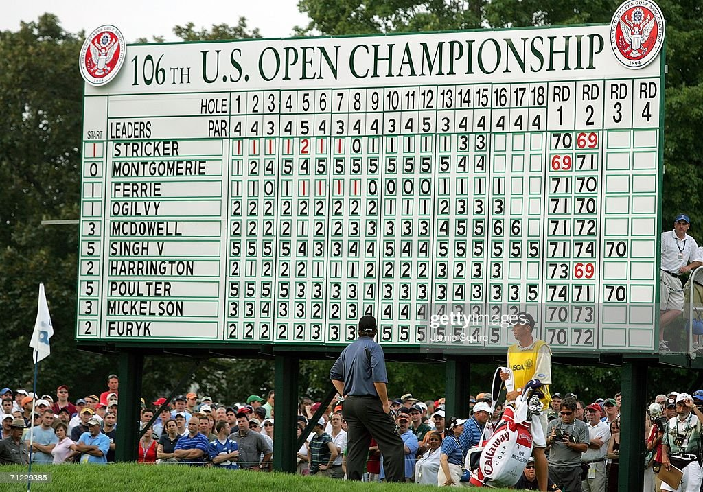 Phil Mickelson examines the leaderboard on the 18th hole with his caddie Jim Mackay during the third round of the 2006 US Open Championship at Winged Foot Golf Club on June 17, 2006 in Mamaroneck, New York.