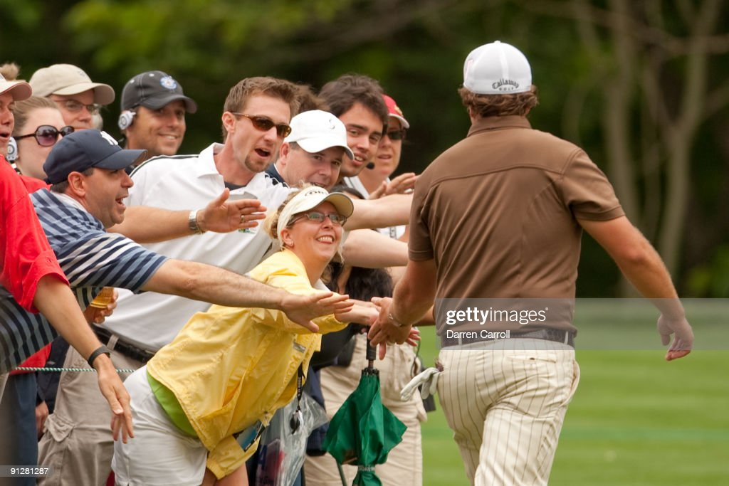 Phil Mickelson greets fans as he walks through the gallery during the continuation of the final round of the 109th U.S. Open Championship on the Black Course at Bethpage State Park on Monday, June 22, 2009.
