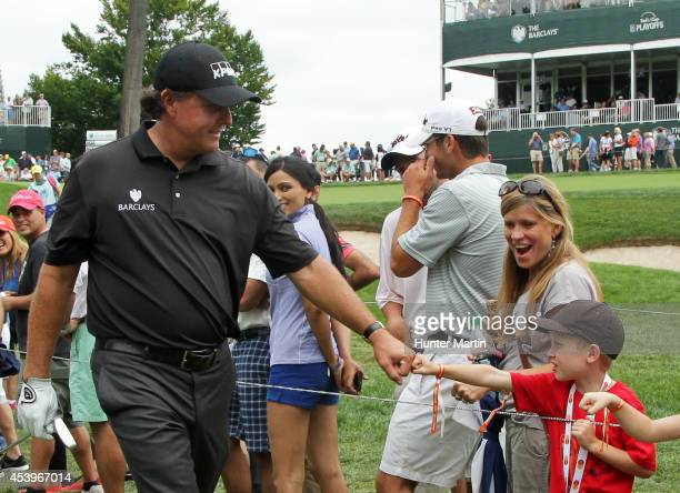Phil Mickelson greets young fans during the second round of The Barclays at The Ridgewood Country Club on August 22 2014 in Paramus New Jersey