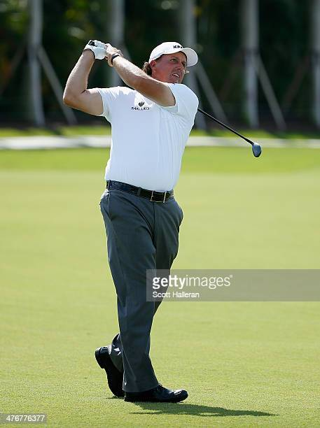 Phil Mickelson hits a shot during a practice round prior to the start of the World Golf Championships-Cadillac Championship at Trump National Doral...