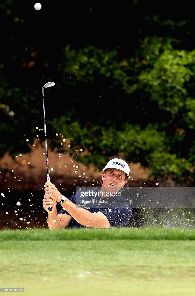 Phil Mickelson hits a shot form the sand on the 4th hole during the second round of the Wells Fargo Championship at Quail Hollow Club on May 3, 2013 in Charlotte, North Carolina.