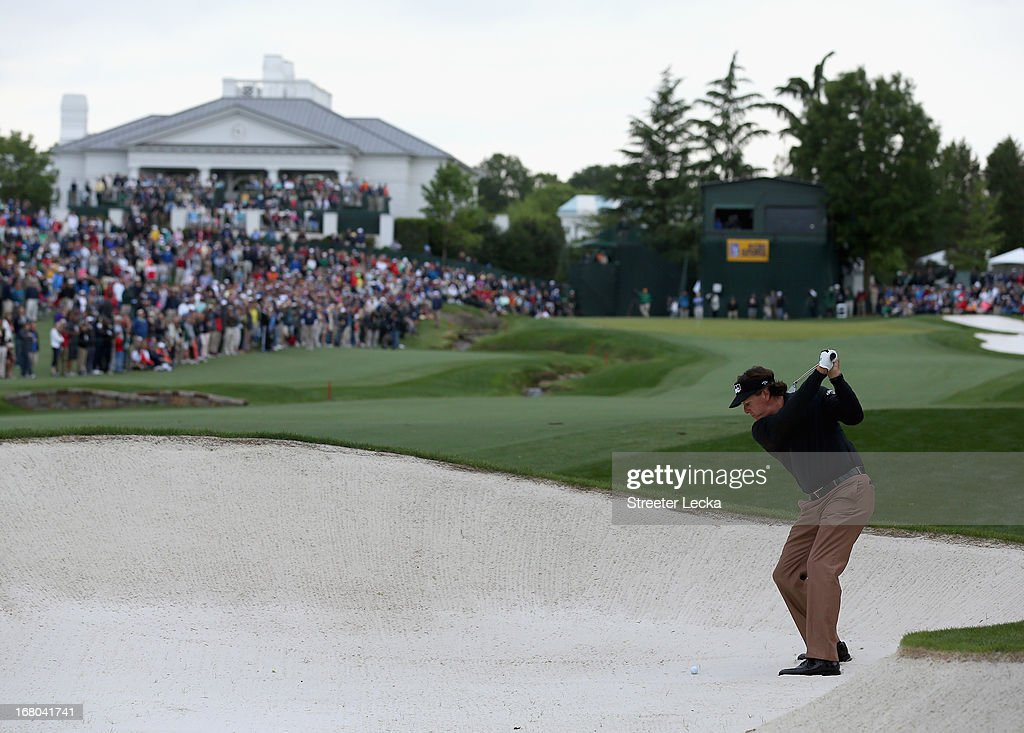 Phil Mickelson hits a shot from the fairway bunker on the 18th hole during the third round of the Wells Fargo Championship at Quail Hollow Club on May 4, 2013 in Charlotte, North Carolina.