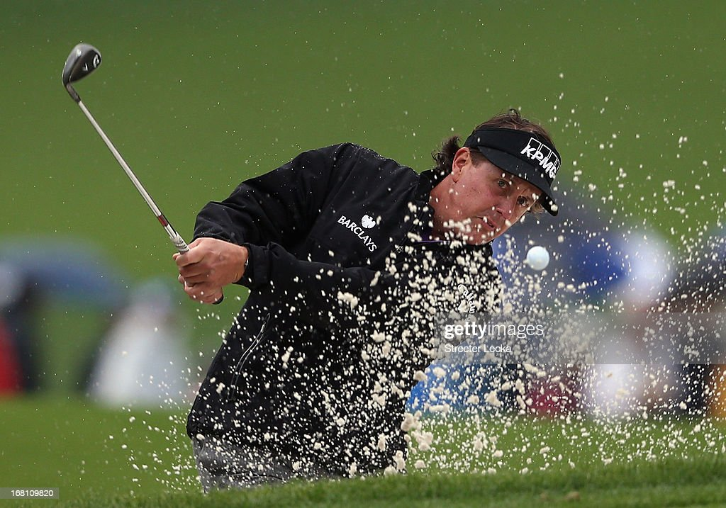 Phil Mickelson hits a shot from the sand on the 15th hole during the final round of the Wells Fargo Championship at Quail Hollow Club on May 5, 2013 in Charlotte, North Carolina.