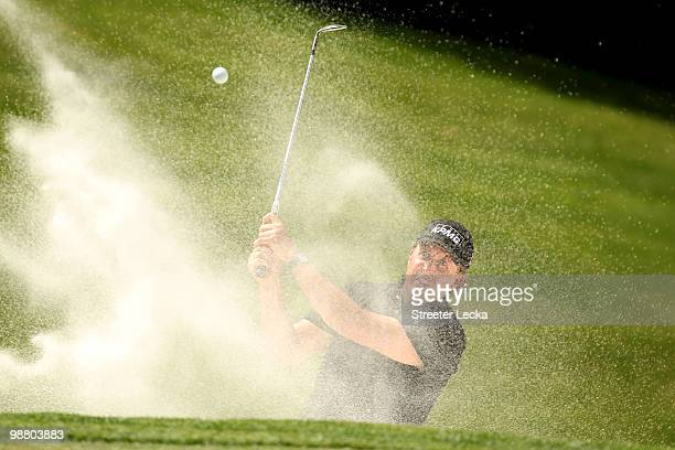 Phil Mickelson hits a shot from the sand on the 8th hole during the final round of the Quail Hollow Championship at Quail Hollow Country Club on May...