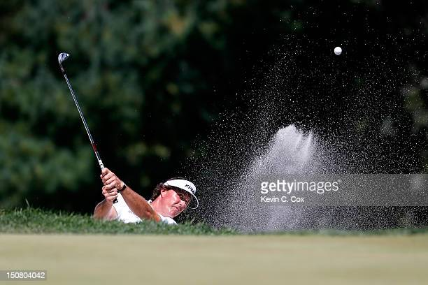 Phil Mickelson hits a shot out of the bunker on the third hole during the final round of The Barclays at the Black Course at Bethpage State Park...