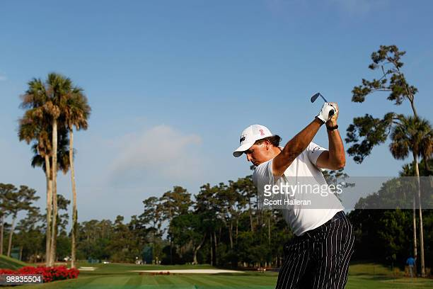 Phil Mickelson hits a tee shot during a practice round prior to the start of THE PLAYERS Championship held at THE PLAYERS Stadium course at TPC...