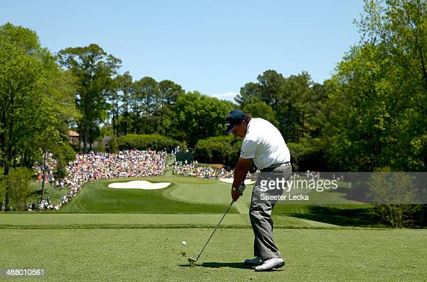 Phil Mickelson hits a tee shot on the 13th hole during the third round of the Wells Fargo Championship at Quail Hollow Club on May 3, 2014 in...