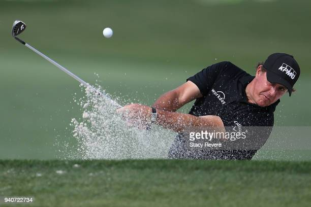 Phil Mickelson hits from a green side bunker on the eighth hole during the final round of the Houston Open at the Golf Club of Houston on April 1...