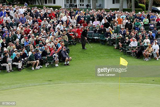 Phil Mickelson hits from the crowd to the 18th green during the continuation of the rain delayed third round of The Masters at the Augusta National...