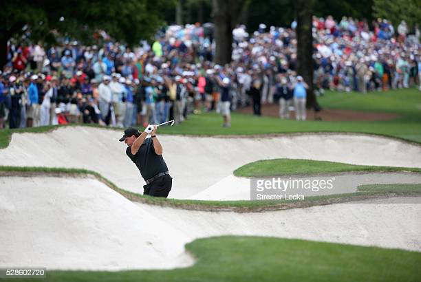 Phil Mickelson hits from the sand on the seventh hole during the second round of the 2016 Wells Fargo Championship at Quail Hollow Club on May 6 2016...