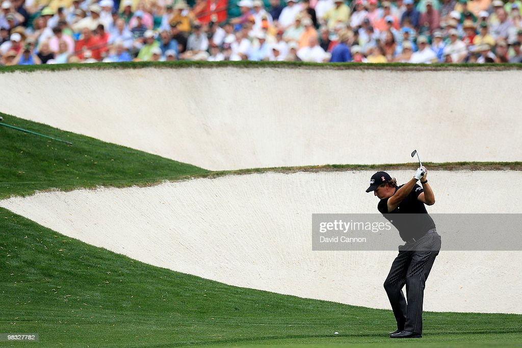 Phil Mickelson hits his approach shot on the fifth hole during the first round of the 2010 Masters Tournament at Augusta National Golf Club on April 8, 2010 in Augusta, Georgia.