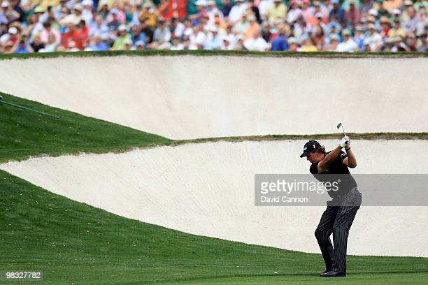 Phil Mickelson hits his approach shot on the fifth hole during the first round of the 2010 Masters Tournament at Augusta National Golf Club on April...