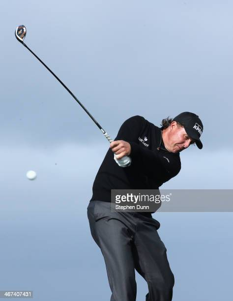 Phil Mickelson hits his tee shot on the 13th hole during the first round of the ATT Pebble Beach National ProAm at Monterey Peninsula Country Club on...