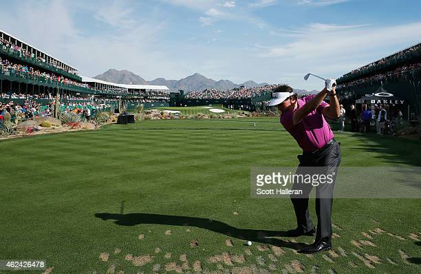 Phil Mickelson hits his tee shot on the 16th hole during the proam prior to the start of the Waste Management Phoenix Open at TPC Scottsdale on...