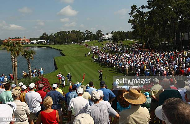 Phil Mickelson hits his tee shot on the 18th hole during the first round of THE PLAYERS Championship held at THE PLAYERS Stadium course at TPC...