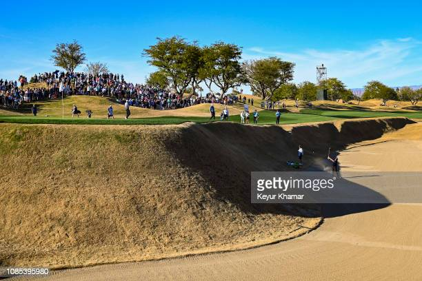 Phil Mickelson hits his third shot from the greenside bunker on the 16th hole during the third round of the Desert Classic on the Stadium Course at...