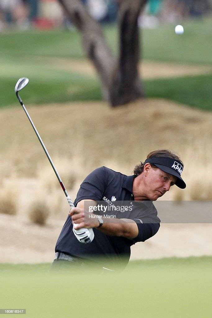 Phil Mickelson hits his third shot on the 15th hole during the final round of the Waste Management Phoenix Open at TPC Scottsdale on February 3, 2013 in Scottsdale, Arizona.