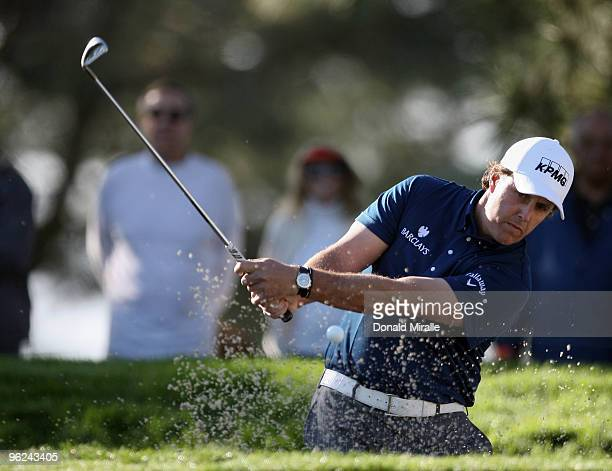 Phil Mickelson hits out of the bunker on the 1st hole during the 2010 Farmers Insurance Open, Round 1 on January 28, 2010 at Torrey Pines in La...