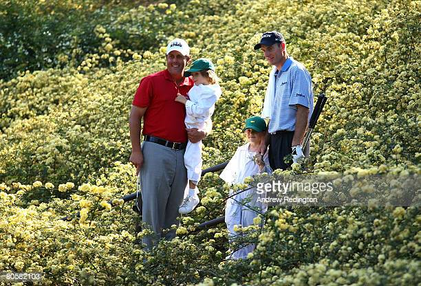 Phil Mickelson holds his son Evan and Jim Furyk stands with his daugher Caleigh Lynn during the Par 3 Contest prior to the start of the 2008 Masters...