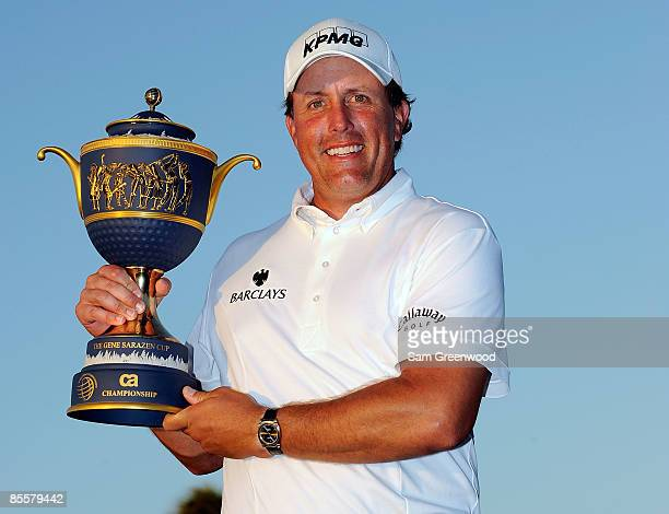 Phil Mickelson holds the trophy after winning during the World Golf ChampionshipsCA Championship at the Doral Golf Resort Spa on March 15 2009 in...