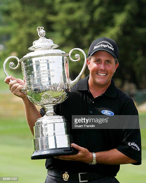 Phil Mickelson holds up the Wanamaker trophy after winning the 2005 PGA Championship with a 4under par 276 on August 15 2005 in Springfield New Jersey