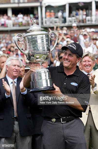 Phil Mickelson holds up the Wanamaker Trophy after winning the 87th PGA Championship at Baltusrol Golf Club in Springfield, N.J.