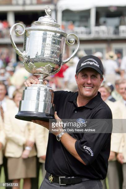 Phil Mickelson holds up the Wanamaker Trophy after winning the 87th PGA Championship at Baltusrol Golf Club in Springfield NJ