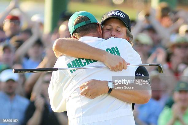 Phil Mickelson hugs his caddie Jim Mackay after his threestroke victory after winning the 2010 Masters Tournament at Augusta National Golf Club on...