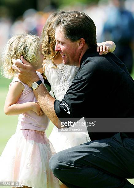 Phil Mickelson hugs his daughter Sophia and Amanda after winning the 2005 PGA Championship with a 4under par 276 on August 15 2005 in Springfield New...