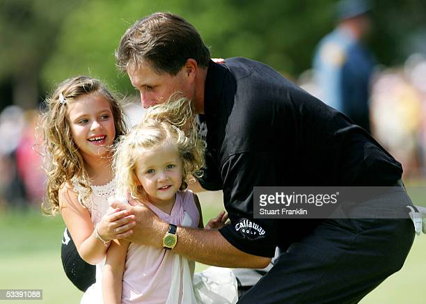 Phil Mickelson hugs his daughters Amanda and Sophia after winning the 2005 PGA Championship with a 4under par 276 on August 15 2005 in Springfield...