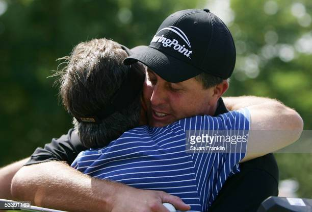 Phil Mickelson hugs his swing coach Rick Smith after winning the 2005 PGA Championship with a 4-under par 276 on August 15, 2005 in Springfield, New...