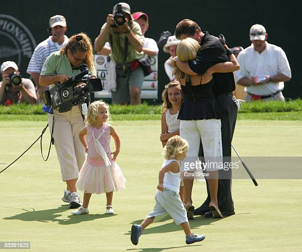 Phil Mickelson is congratulated by his wife Amy his daughters Sophia Evan and Amanda after winning the 2005 PGA Championship with a 4under par 276 on...