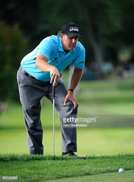 Phil Mickelson lines up his putt on the 17th hole during round two of the 90th PGA Championship at Oakland Hills Country Club on August 8 2008 in...