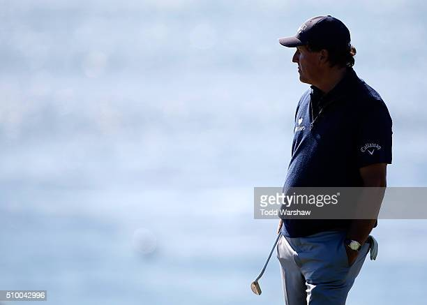 Phil Mickelson looks on near the fourth green during round three of the ATT Pebble Beach National ProAm at the Pebble Beach Golf Links on February 13...