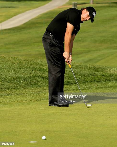 Phil Mickelson makes a birdie putt on the 14th hole at the North Course at Torrey Pines Golf Course during the second round of the Farmers Insurance...