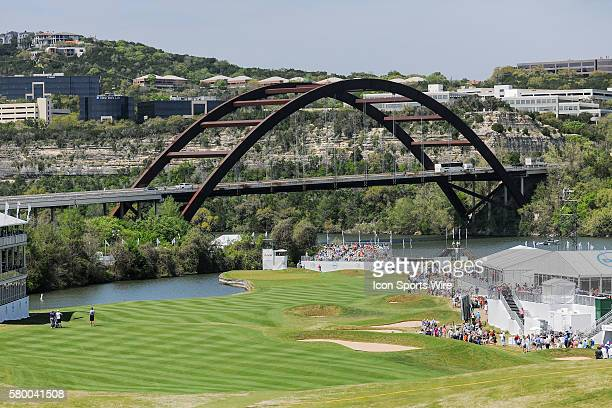 Phil Mickelson makes his way down the left side of the fairway as Austin's Loop 360 bridge looms behind hole number 12 during the World Golf...