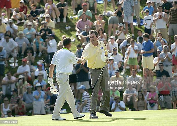 Phil Mickelson of Rancho Santa Fe Califormia and Alex Cejka of Germany shake on 18 during the final round at the 2005 Booz Allen Classic at the...