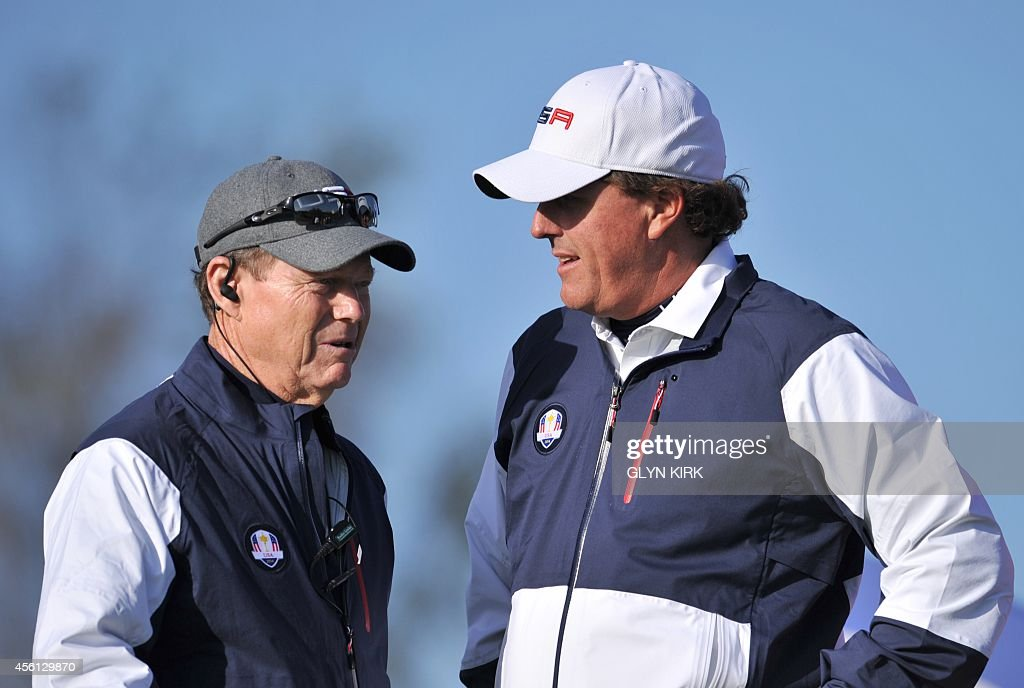 Phil Mickelson of Team US (R) speaks with US Team Captain Tom Watson on the sixth tee during the fourball match on the first day of the Ryder Cup golf tournament at the Gleneagles Hotel in Gleneagles, Scotland, on September 26, 2014.