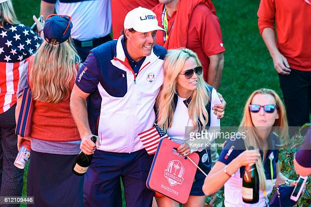 Phil Mickelson of Team USA celebrates with his wife Amy Mickelson following his team's victory during singles matches of the 2016 Ryder Cup at...
