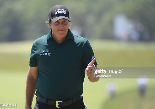 Phil Mickelson of the United States acknowledges the crowd singing 'Happy Birthday' on the third green during the third round of the 2018 US Open at...
