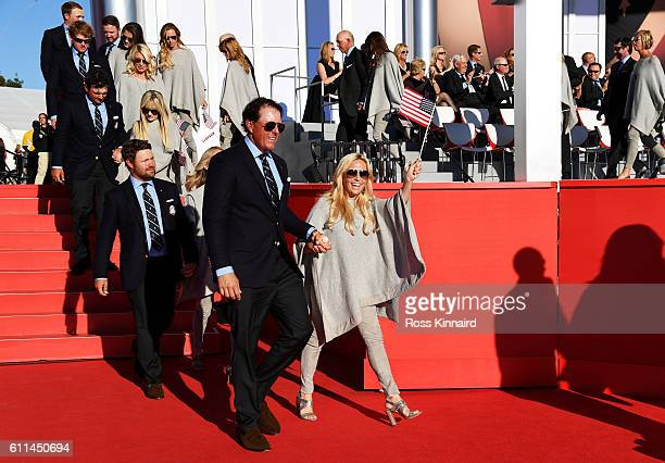Phil Mickelson of the United States and Amy Mickelson depart the 2016 Ryder Cup Opening Ceremony at Hazeltine National Golf Club on September 29 2016...