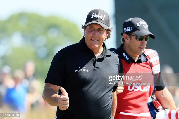 Phil Mickelson of the United States and caddie Tim Mickelson walk on the seventh hole during the final round of the 2018 US Open at Shinnecock Hills...