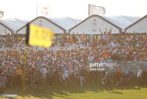 Phil Mickelson of the United States and fans cheer as he walks up the 18th fairway during the final round of the 2021 PGA Championship held at the...