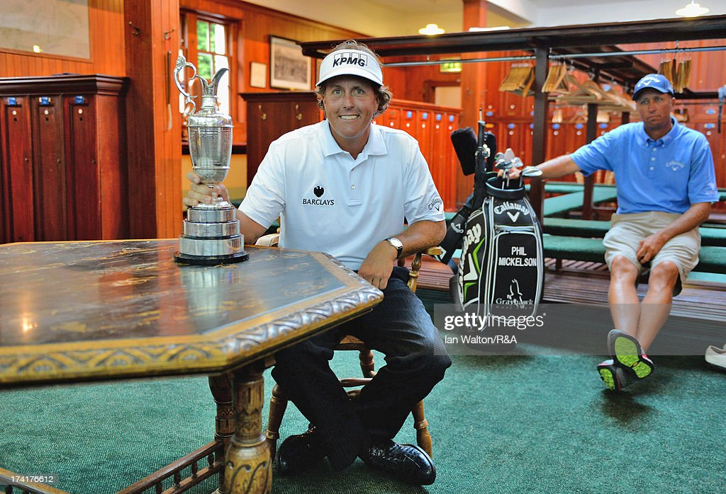 Phil Mickelson of the United States and his caddie Jim Mackay pose in the player's locker room with the Claret Jug after winning the 142nd Open Championship at Muirfield on July 21, 2013 in Gullane, Scotland.