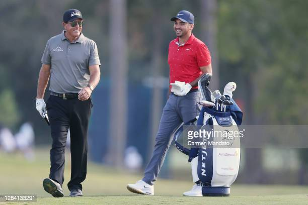 Phil Mickelson of the United States and Jason Day of Australia laugh on the third hole during the first round of the Vivint Houston Open at Memorial...