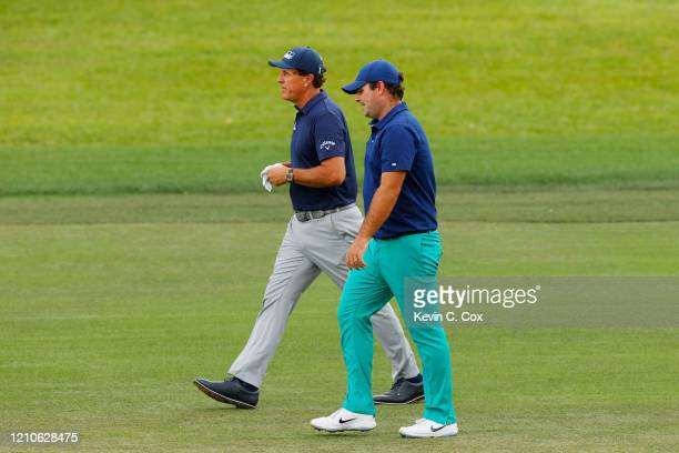 Phil Mickelson of the United States and Patrick Reed of the United States walk on the fourth hole during the first round of the Arnold Palmer...
