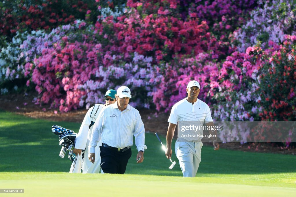 Phil Mickelson of the United States and Tiger Woods of the United States walk onto the 13th green during a practice round prior to the start of the 2018 Masters Tournament at Augusta National Golf Club on April 3, 2018 in Augusta, Georgia.