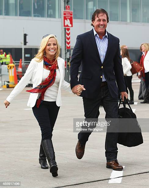Phil Mickelson of the United States and wife Amy Mickelson arrive at Edinburgh Airport ahead of the 2014 Ryder Cup at Gleneagles on September 22 2014...