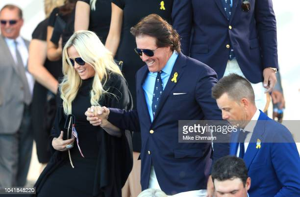 Phil Mickelson of the United States and wife Amy Mickelson depart the opening ceremony for the 2018 Ryder Cup at Le Golf National on September 27...